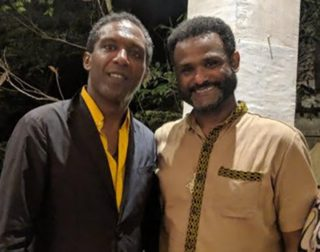 Lemn Sissay: author, broadcaster, poet and Chancellor of the University of Manchester, pictured here together with CHRE lectur-er, poet, author and activist Yirga Woldeyes.